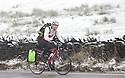 12/01/17<br />  <br /> A cyclist braves snowy conditions as he rides over the Peak District near Glossop in Derbyshire.<br /> <br /> All Rights Reserved F Stop Press Ltd. (0)1773 550665   www.fstoppress.com