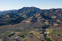 aerial photograph of vineyards at the base of Mount St. Helena, Calistoga, Napa County, California, the Napa River is at right, flowing from its headwaters at Mount St. Helena; Tamber Bay Vineyards is in the foreground left,  the Old Faithful Geyser of California at the foreground center.
