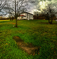 The 1882 marker sits surrounded by grass in the fall beside the old farm house at the Braun Farm. An iPhone stitched panorama.