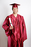 A 2013 graduate in a red cap and gown