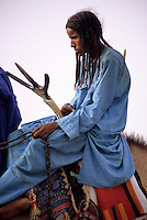In-Gall, near Agadez, Niger - Tuareg Young Man on Camel, Saddle visible.