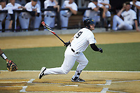Brendan Tinsman (9) of the Wake Forest Demon Deacons follows through on his swing against the Davidson Wildcats at David F. Couch Ballpark on May 7, 2019 in  Winston-Salem, North Carolina. The Demon Deacons defeated the Wildcats 11-8. (Brian Westerholt/Four Seam Images)