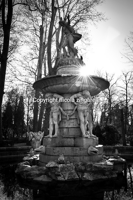 Prince's garden in Aranjuez, the beautiful garden of the royal court with old trees, gorgeous houses, mansions, wild animals and near the Tajo river. Detail of Narciso's fountain