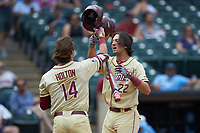 Drew Mendoza (22) of the Florida State Seminoles celebrates with teammate Tyler Holton (14) after scoring a run during the game against the North Carolina Tar Heels in the 2017 ACC Baseball Championship Game at Louisville Slugger Field on May 28, 2017 in Louisville, Kentucky. The Seminoles defeated the Tar Heels 7-3. (Brian Westerholt/Four Seam Images)