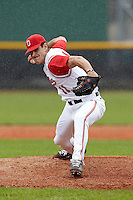 Ohio State Buckeyes pitcher David Fathalikhani #11 delivers a pitch during a game against the USF Bulls at the Big Ten/Big East Challenge at Walter Fuller Complex on February 17, 2012 in St. Petersburg, Florida.  (Mike Janes/Four Seam Images)