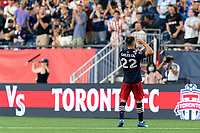 FOXBOROUGH, MA - JULY 7: Carles Gil #22 of New England Revolution celebrates his goal during a game between Toronto FC and New England Revolution at Gillette Stadium on July 7, 2021 in Foxborough, Massachusetts.
