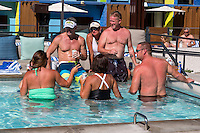 Las Vegas, Nevada.  Middle-aged Bathers Relaxing at the Pool, The Linq Hotel.