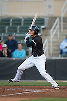 Antonio Rodriguez (6) of the Kannapolis Intimidators follows through on his swing against the Hickory Crawdads at Kannapolis Intimidators Stadium on April 8, 2016 in Kannapolis, North Carolina.  The Crawdads defeated the Intimidators 8-2.  (Brian Westerholt/Four Seam Images)