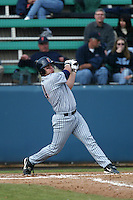 P.J. Pilittere of the Cal State Fullerton Titans bats during a 2004 season game against the Loyola Marymount Lions at Loyola Marymount in Los Angeles, California. (Larry Goren/Four Seam Images)