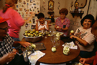 Caudill family members gather on weekends and work in the garden and to maintain the homestead. They harvested apples in the last garden Therman grew at his home. Sitting around the table, they joked and worked together to can. They sold the home and moved into town after years of living next to a coal mine that inched closer and loomed over the house.