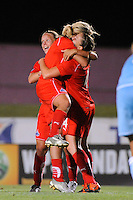 Cat Whitehill (4) of the Washington Freedom celebrates scoring the game tying goal with Allie Long (9) and Lori Lindsey (6). Sky Blue FC and the Washington Freedom played to a 4-4 tie during a Women's Professional Soccer match at Yurcak Field in Piscataway, NJ, on July 15, 2009.