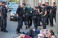 """Rechtsextreme """"Identitaere"""" versuchen Besetzung des Justizministerium.<br /> Am Freitag den 19. Mai 2017 versuchten ca. 40 Rechtsextremisten der sog. """"Identitaeren Bewegung"""" (IB) das Justizministerium zu besetzen. Sie setzten das Ministerium und den Justizminister Maas mit der Staatssicherheit der DDR gleich, hatten DDR-Fahnen dabei und trugen zum Teil DDR-Militaeruniformen.<br /> Die Neonazis scheiterten jedoch mit der Besetzung, da die Polizei im Vorfeld von der Aktion informiert war und rechtzeitig vor Ort war. Als die Polizei die Neonazis aufforderte zu gehen, legten die sich auf den Fußweg und skandierten """"Keine Gewalt"""" und Parolen gegen Fluechtlinge und fuer Deutschland. Daraufhin wurden die Neonazis einzeln abgefuehrt, durchsucht und erhielten einen Platzverweis.<br /> Im Bild: Polizei fuehrt sog. """"Identitaere"""" ab.<br /> 19.5.2017, Berlin<br /> Copyright: Christian-Ditsch.de<br /> [Inhaltsveraendernde Manipulation des Fotos nur nach ausdruecklicher Genehmigung des Fotografen. Vereinbarungen ueber Abtretung von Persoenlichkeitsrechten/Model Release der abgebildeten Person/Personen liegen nicht vor. NO MODEL RELEASE! Nur fuer Redaktionelle Zwecke. Don't publish without copyright Christian-Ditsch.de, Veroeffentlichung nur mit Fotografennennung, sowie gegen Honorar, MwSt. und Beleg. Konto: I N G - D i B a, IBAN DE58500105175400192269, BIC INGDDEFFXXX, Kontakt: post@christian-ditsch.de<br /> Bei der Bearbeitung der Dateiinformationen darf die Urheberkennzeichnung in den EXIF- und  IPTC-Daten nicht entfernt werden, diese sind in digitalen Medien nach §95c UrhG rechtlich geschuetzt. Der Urhebervermerk wird gemaess §13 UrhG verlangt.]"""