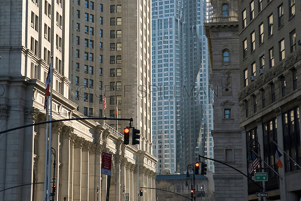 Lower Manhattan's Civic Center in Late Afternoon Light, Centre Street, New York City, New York State, USA.<br /> <br /> The Municipal Building is on the left, Frank Gehry's residental tower 8 Spruce Street is in the middle and the Surrogate's Court Building is on the right.