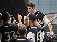 June 20, 2009: Kade Keowen (47) is congratulated by fellow Greenville Drive players after he scored during a game that clinched the first half Southern Division title for the South Atlantic League. The Drive took the title with a 15-3 win over the Lexington Legends at Fluor Field at the West End in Greenville, S.C. Drive players were wearing Greenville Mill League throwback jerseys that were being auctioned off after the game. Photo by: Tom Priddy/Four Seam Images