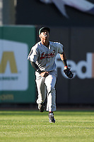Great Lakes Loons outfielder Alex Santana (21) tracks down a fly ball during a game against the West Michigan Whitecaps on June 5, 2014 at Fifth Third Ballpark in Comstock Park, Michigan.  West Michigan defeated Great Lakes 6-2.  (Mike Janes/Four Seam Images)