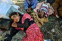 Iraq 2014       <br /> August 10, young Yezidi girl , exhausted, lying on the ground when she arrived in Pesh Kabur  <br /> Irak 2014 <br /> 10 aout, jeune fille Yezidi, extenuée, allongée a meme le sol en arrivant a Pesh Kabur