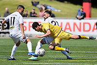 Riley Bidois of the Wellington Phoenix competes for the ball with Mario Barcia of Team Wellington during the ISPS Handa Men's Premiership - Wellington Phoenix v Team Wellington at Fraser Park, Wellington on Saturday 14 November 2020.<br /> Copyright photo: Masanori Udagawa /  www.photosport.nz