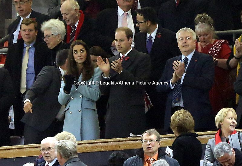 Pictured L-R: Princess Kate, Prince William and First Minister for Wales Carwyn Jones applaud after the final whistle. Saturday 08 November 2014<br /> Re: Dove Men Series rugby, Wales v Australia at the Millennium Stadium, Cardiff, south Wales, UK.