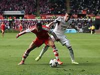 Saturday, 03 May 2014<br /> Pictured L-R: Nathaniel Clyne of Southampton against Pablo Hernandez of Swansea.<br /> Re: Barclay's Premier League, Swansea City FC v Southampton at the Liberty Stadium, south Wales.
