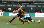 Rhodri  Gomer-Davies gets the ball wide while under pressure from Glasgows Graeme Morrison Newport Gwent Dragons Vs Glasgow Warriors Magners League  Copyright IJC Photography Photographer Ian Cook