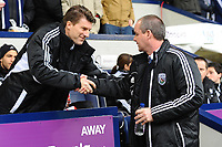 Saturday, 9 March 2013<br /> <br /> Pictured: Michael Laudrup Manager of Swansea City shakes hands with Steve Clarke Head Coach of West Bromwich Albion<br /> <br /> Re: Barclays Premier League West Bromich Albion v Swansea City FC  at the Hawthorns, Birmingham, West Midlands