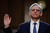 WASHINGTON, DC - FEBRUARY 22: Attorney General nominee Merrick Garland is sworn-in during his confirmation hearing before the Senate Judiciary Committee in the Hart Senate Office Building on February 22, 2021 in Washington, DC. Garland previously served at the Chief Judge for the U.S. Court of Appeals for the District of Columbia Circuit. <br /> Credit: Drew Angerer / Pool via CNP /MediaPunch