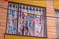 BOGOTA - COLOMBIA, 25-05-2021: Una mujer observa desde su ventana durante los disturbios en el sector de las Américas de la ciudad de Bogotá durante el día 28 del Paro Nacional en Colombia hoy, 25 de mayo de 2021, para protestar contra el gobierno de Ivan Duque además de la precaria situación social y económica que vive Colombia. El paro fue convocado por sindicatos, organizaciones sociales, estudiantes y la oposición. / A woman observes from her window during the riots at Portal Las Americas sector of the city of Bogota during the day 28 of the National strike in Colombia today, May 25, 2021, to protest against the government of Ivan Duque in addition to the precarious social and economic situation that Colombia is experiencing. The strike was called by unions, social organizations, students and the opposition in Colombia. Photo: VizzorImage / Diego Cuevas / Cont