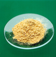 SAMPLE OF GOLD POWDER - Green background<br /> A Dense Soft Shiny Metal. The element gold is the most malleable and ductile of all known metals.