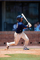 Mobile BayBears first baseman Luis Tejada (19) follows through on a swing during a game against the Pensacola Blue Wahoos on April 26, 2017 at Hank Aaron Stadium in Mobile, Alabama.  Pensacola defeated Mobile 5-3.  (Mike Janes/Four Seam Images)