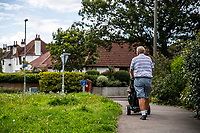 BNPS.co.uk (01202 558833)<br /> Pic: MaxWillcock/BNPS<br /> Date taken: 28/07/2021<br /> <br /> Pictured: A golfer (NOT RELATED TO THE CASE) on Lymington Road in Highcliffe, Dorset.<br /> <br /> The 'Rolex Rippers' are believed to have struck 23 times in southern England, especially in Dorset and Hampshire.<br /> <br /> The serial watch thieves target elderly men for their expensive watches in affluent areas and close to exclusive golf clubs.