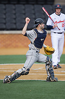 Georgetown Hoyas catcher Eric Webber (21) makes a throw to third base against the Bucknell Bison at Wake Forest Baseball Park on February 14, 2015 in Winston-Salem, North Carolina.  The Hoyas defeated the Bison 8-5.  (Brian Westerholt/Four Seam Images)