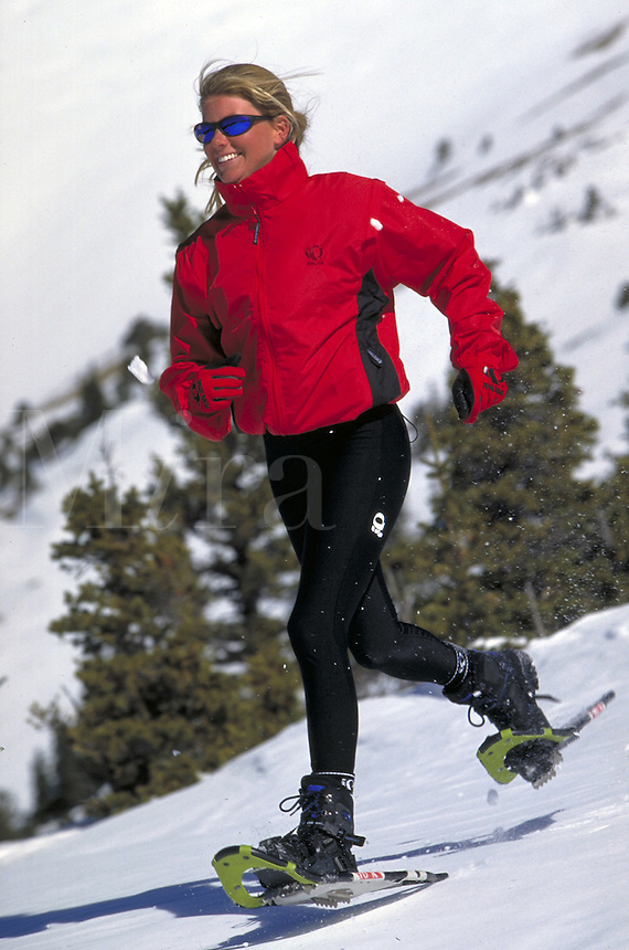 Winter, Vacation, Sports, Active Lifestyle, Adventure, Snowshoeing, Wilderness, Woman, Happiness, Exercise, Fitness, Training, Snowshoes. Amy Meckstroth (MR 699). Backcountry Colorado United States Rocky Mountains, Summit County, Hoosier Pass.