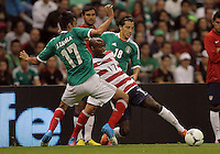 MEXICO CITY, MEXICO - AUGUST 15, 2012:  DaMarcus Beasley (17) of the USA MNT pokes the ball away from Jesus Zavala (17) and Andres Guardado (18) of  Mexico during an international friendly match at Azteca Stadium, in Mexico City, Mexico on August 15. USA won 1-0.