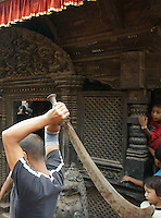 Newar man with traditional sword  in process of sacrificing a buffalo in dashein festival time in Bhaktapur, Nepal. Newar culture is famous for blending Hindu and tantric buddhist tradtions in Nepal, also rooted in earlier animistic tradtions, as both Hindu and Buddhist culture do in parts - as can be seen in archaic rituals of Dashein sacrifices for goddess Durga and her nine incarnations.