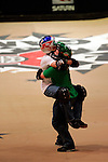 Kevin Robinson celebrates his landing of the double flair with Chad Kagy while competing in the BMX Freestyle Vert Best Trick finals during X-Games 12 in Los Angeles, California on August 4, 2006.