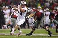 SEATTLE, WA - September 28, 2013: Stanford linebacker Blake Lueders rushes the quarterback as Washington State offensive linesman Gunnar Eklund tries to block during play at CenturyLink Field. Stanford won 55-17.