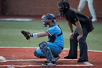 Old Dominion Monarchs catcher Brock Gagliardi (10) sets a target as home plate umpire Jeff Francis looks on during the game against the Charlotte 49ers at Hayes Stadium on April 25, 2021 in Charlotte, North Carolina. (Brian Westerholt/Four Seam Images)