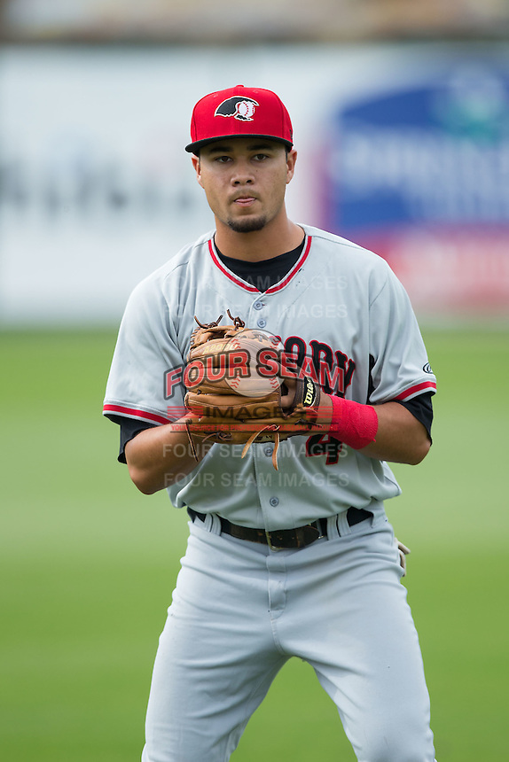 Isiah Kiner-Falefa (4) of the Hickory Crawdads warms up in the outfield prior to the game against the Kannapolis Intimidators at CMC-Northeast Stadium on April 17, 2015 in Kannapolis, North Carolina.  The Crawdads defeated the Intimidators 9-5 in game one of a double-header.  (Brian Westerholt/Four Seam Images)