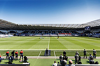 Players, coaching staff and match officials observe a minute's silence in tribute to Prince Philip prior to the Sky Bet Championship match Swansea City and Wycombe Wanderers at Liberty Stadium, Swansea, Wales, UK. Saturday 17 April 2021