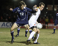 Jason Herrick #9 of the University of Maryland turns the ball away from Andy Parr #12 of Penn State during an NCAA 3rd. round match at Ludwig Field, University of Maryland, College Park, Maryland on November 28 2010.Maryland won 1-0.