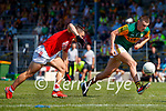 Seán O'Shea, Kerry, in action against Cian Kiely, Cork, during the Munster GAA Football Senior Championship Final match between Kerry and Cork at Fitzgerald Stadium in Killarney on Sunday.