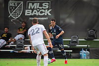 LAKE BUENA VISTA, FL - JULY 22: Luis Martins #36 of Sporting Kansas City dribbles the ball during a game between Real Salt Lake and Sporting Kansas City at Wide World of Sports on July 22, 2020 in Lake Buena Vista, Florida.