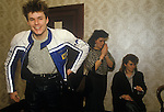 Stuart Adamson,Big Country on tour Scotland. Dressing room with two girl fans, groupies. He is near his family home and will drive his motor bike to go home that evening rather than in the band hotel. 1980s
