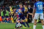 Juan Pablo Anor Acosta, Juanpi (l), of Malaga CF is tackled by Lucas Digne (c) and Andres Iniesta Lujan of FC Barcelona during the La Liga 2017-18 match between FC Barcelona and Malaga CF at Camp Nou on 21 October 2017 in Barcelona, Spain. Photo by Vicens Gimenez / Power Sport Images
