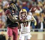 Florida State wide receiver Tamorrion Terry makes a 74 yard touchdown catch in front of Boston College defensive back Brandon Sebastian for the win late in the second half of an NCAA college football game in Tallahassee, Fla., Saturday, Nov. 17, 2018. Florida State defeated Boston College 22-21.  (AP Photo/Mark Wallheiser)