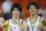 (L-R) Kohei Uchimura, Yusuke Tanaka (JPN), OCTOBER 9, 2014 - Artistic Gymnastics : 2014 World Artistic Gymnastics Championships Medal Ceremony for the Men's Individual All-Around Final at the Guangxi Gymnasium in Nanning, China. (Photo by Yusuke Nakanishi/AFLO SPORT)