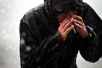 A fisherman caught in a rainstorm in Zhanjiang, Guangdong Province. 2010