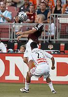 Houston Dynamo defender Wade Barrett (24) keeps his eye on the ball as Chicago Fire midfielder Ivan Guerrero (23) looks on.  Chicago Fire beat Houston Dynamo 1-0 at Robertson Stadium in Houston, TX on April 29, 2007.