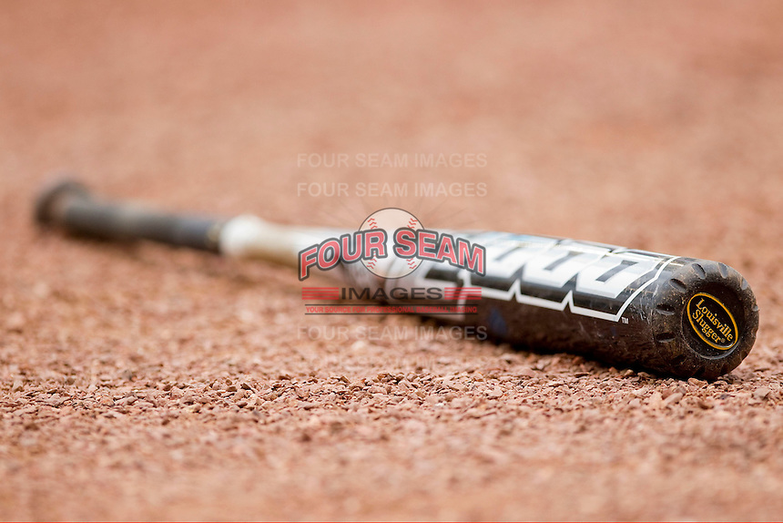A bat made by Louisville Slugger lays on the ground near home plate during the game between the Baylor Bears and the Houston Cougars at Minute Maid Park on March 4, 2011 in Houston, Texas.  All NCAA teams had to switch to BBCOR bats for the 2011 season.  Photo by Brian Westerholt / Four Seam Images