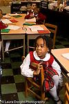 Parochial School Bronx New York  Kindergarten girl listening in class vertical